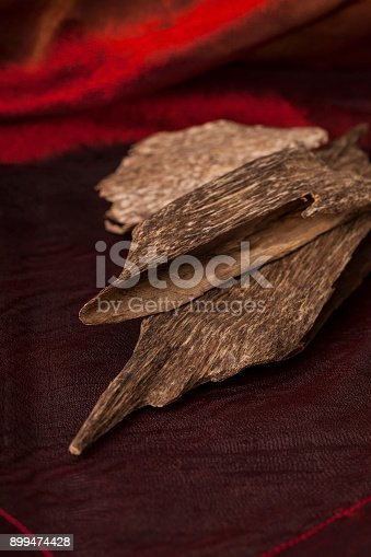 istock Agarwood incense chips 899474428