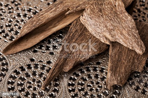 istock Agarwood incense chips 899474432