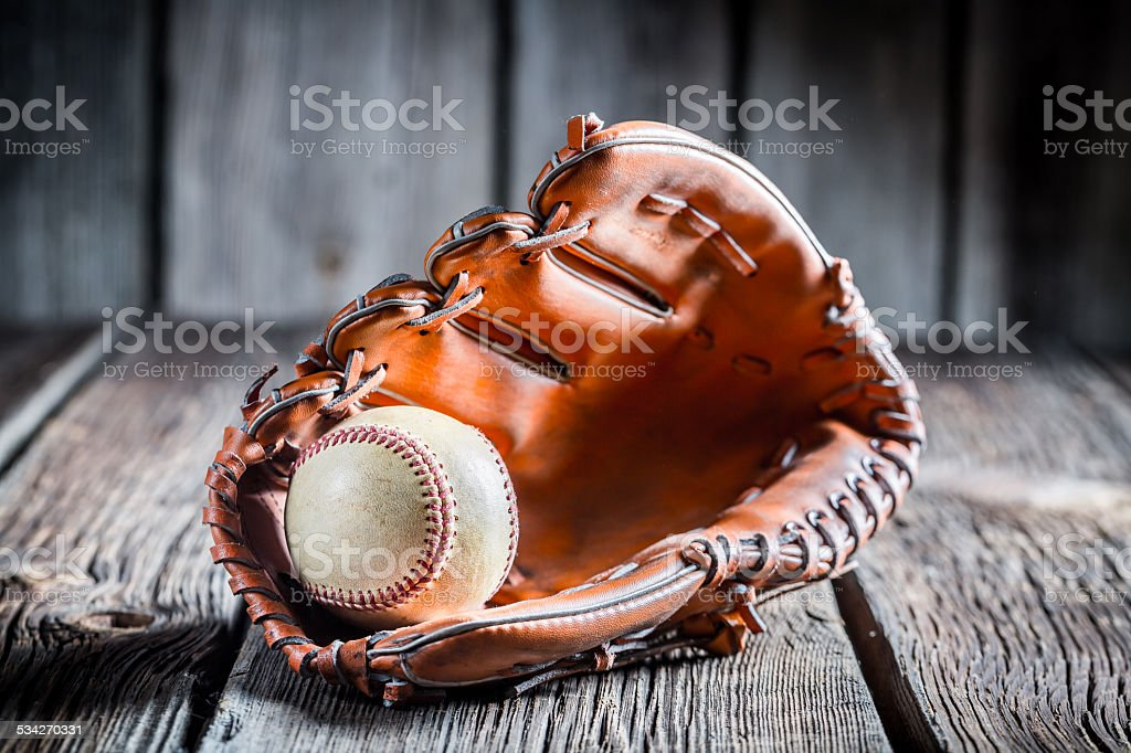 Age Baseball glove and ball stock photo