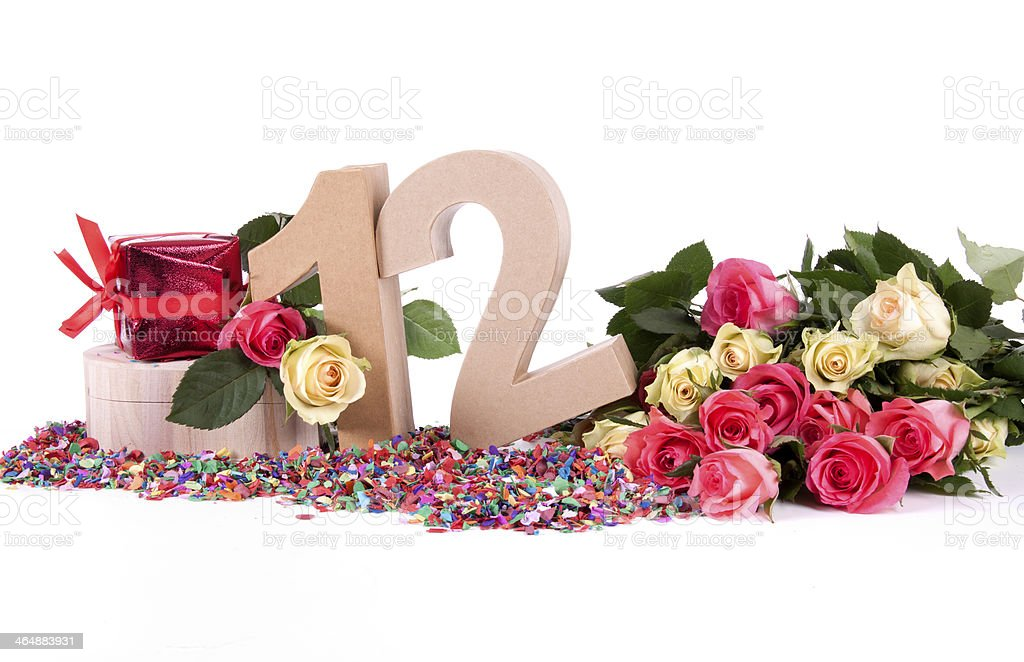 Age in figures, decorated with roses stock photo