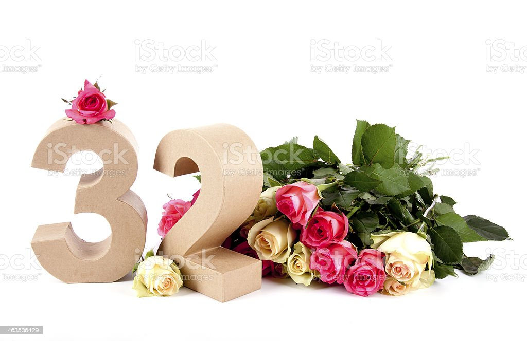 Age in numbers on a bed of roses stock photo