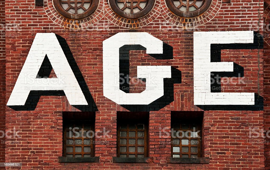 Age: On an Old Brick Building Wall stock photo
