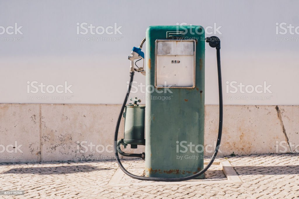 Aged and worn vintage gas oil pump stock photo