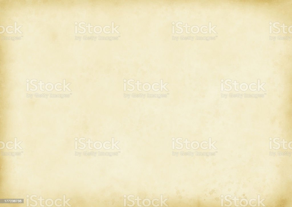 Aged and yellowed parchment background stock photo