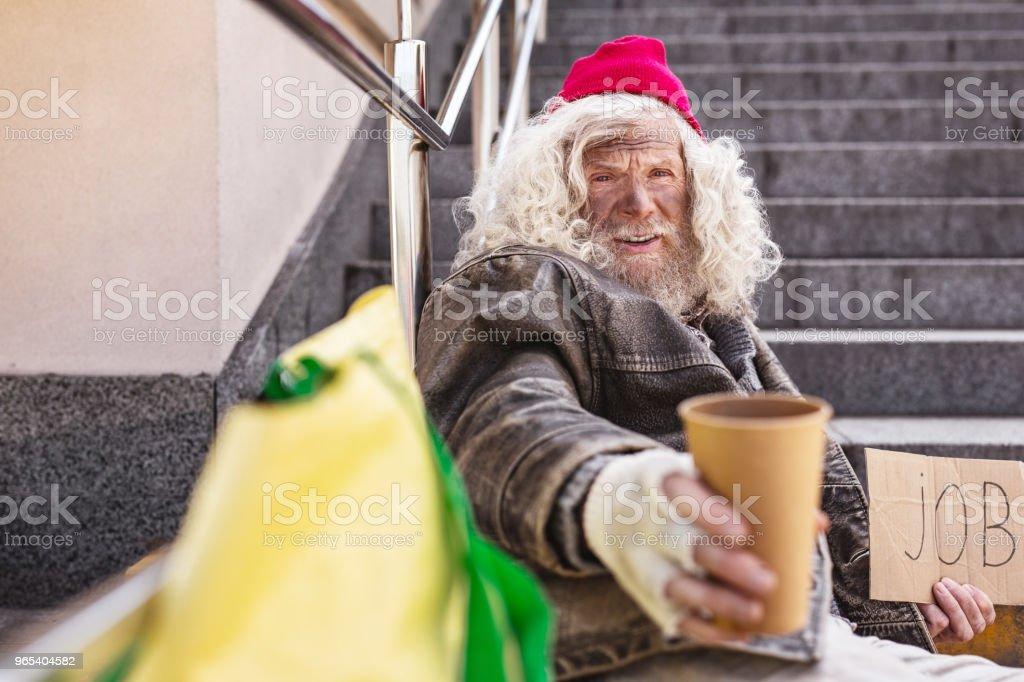 Aged bearded man being homeless zbiór zdjęć royalty-free