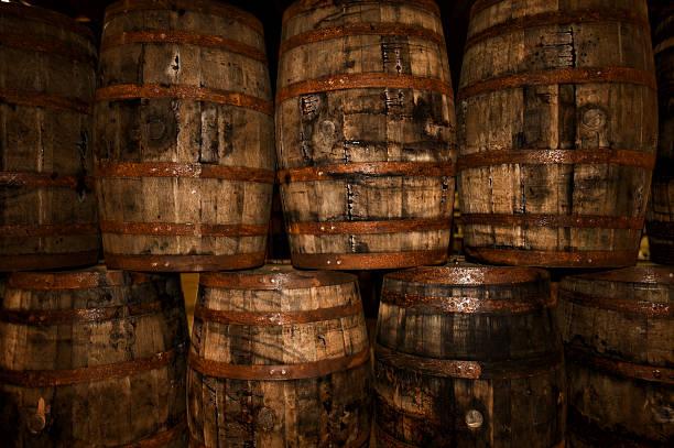 Aged bourbon oak barrels stock photo