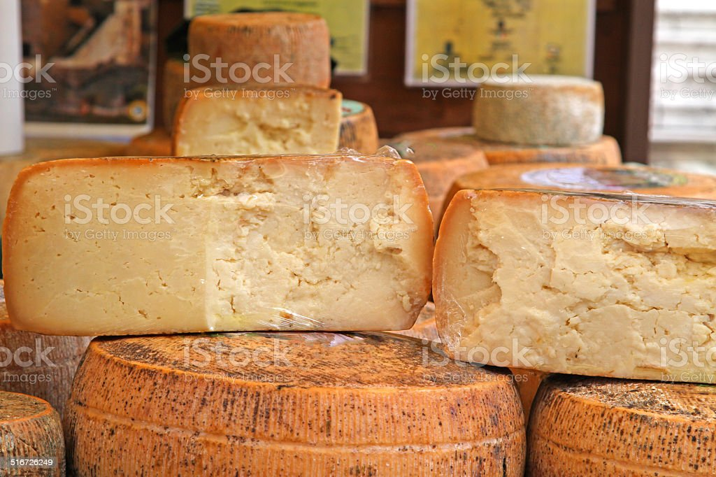 aged cheese on sale in the local market stall stock photo
