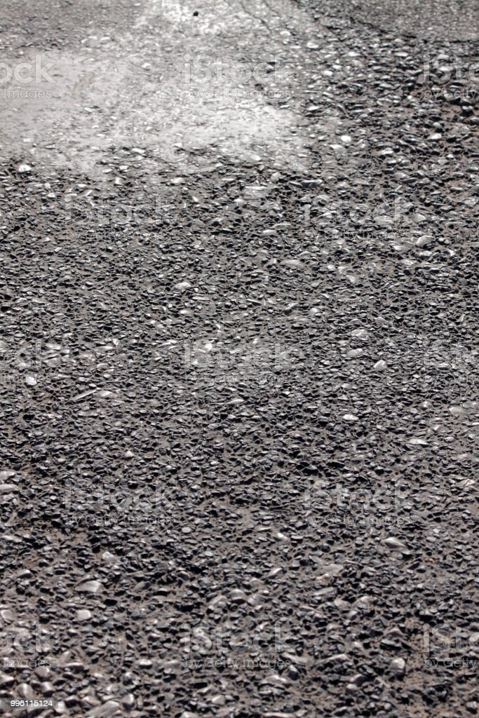 Aged coarse asphaltic road surface stock photo