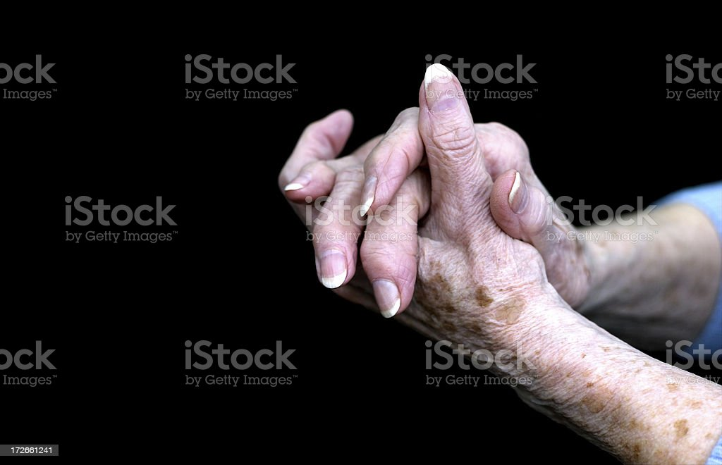 Aged Female Hands Grasped royalty-free stock photo