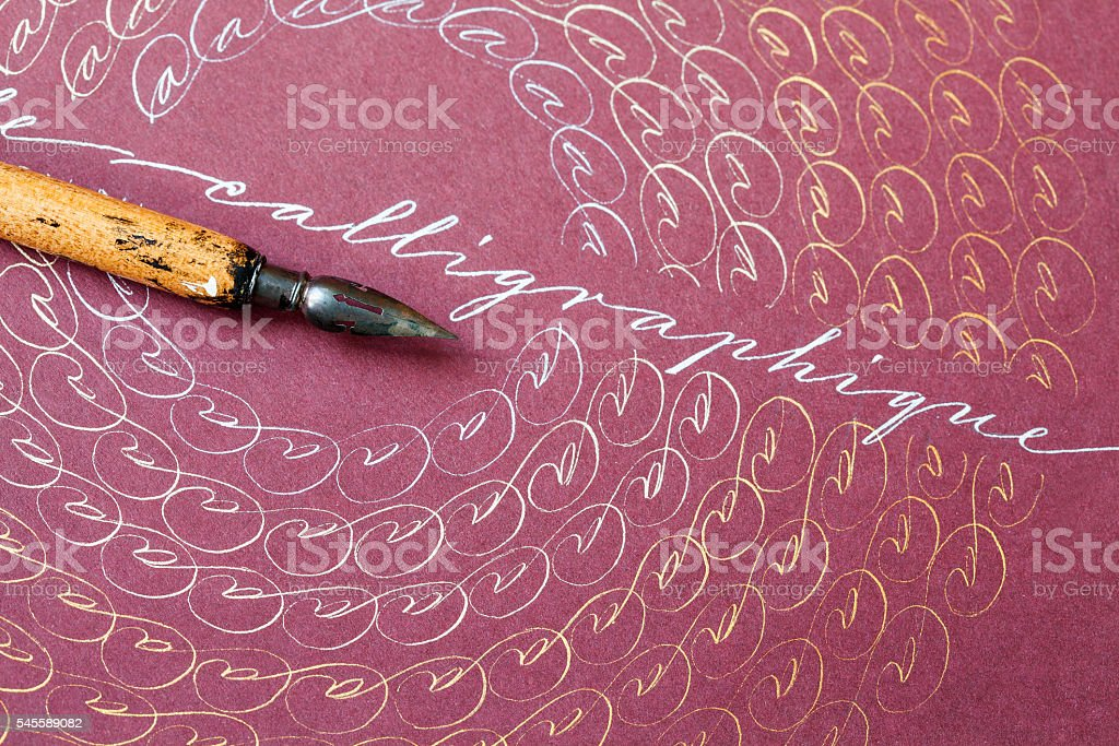 Aged fountain pen, artistic frame with letters A. Word Calligraphique stock photo