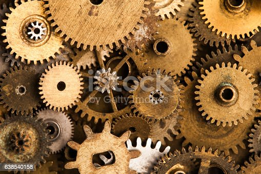 istock Aged gears cogwheels background. Retro mechanical clock accessories close-up 638540158