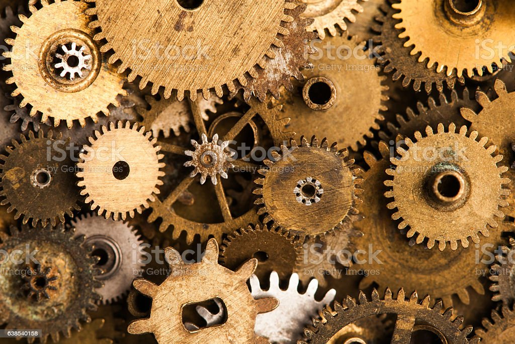 Aged gears cogwheels background. Retro mechanical clock accessories close-up stock photo