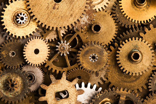 aged gears cogwheels background. retro mechanical clock accessories close-up - steampunk stock photos and pictures