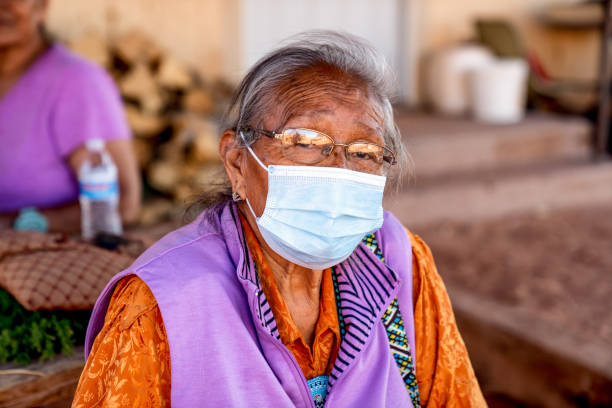 Aged Grandmother Navajo Woman Wearing a Mask to Prevent the Spread of the Corona Virus or Covi-19 stock photo