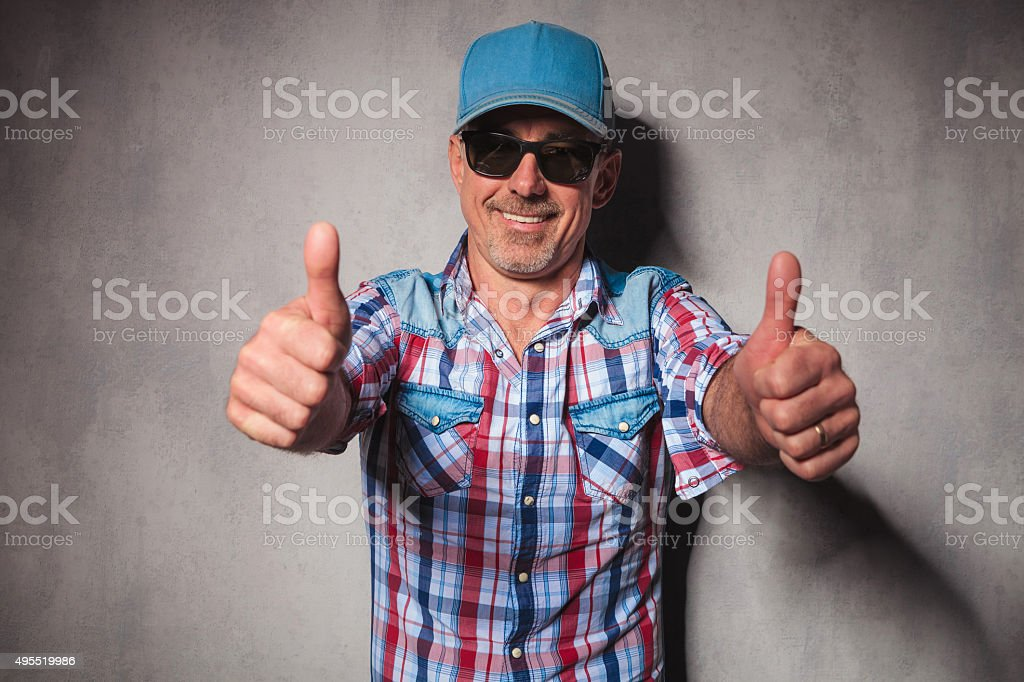 aged happy casual man making the ok sign stock photo