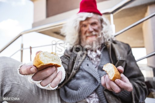Aged Homeless Man Sharing His Bread Stock Photo & More Pictures of Adult
