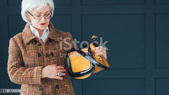 istock aged lady fashion stylist senior woman elegance 1135730046