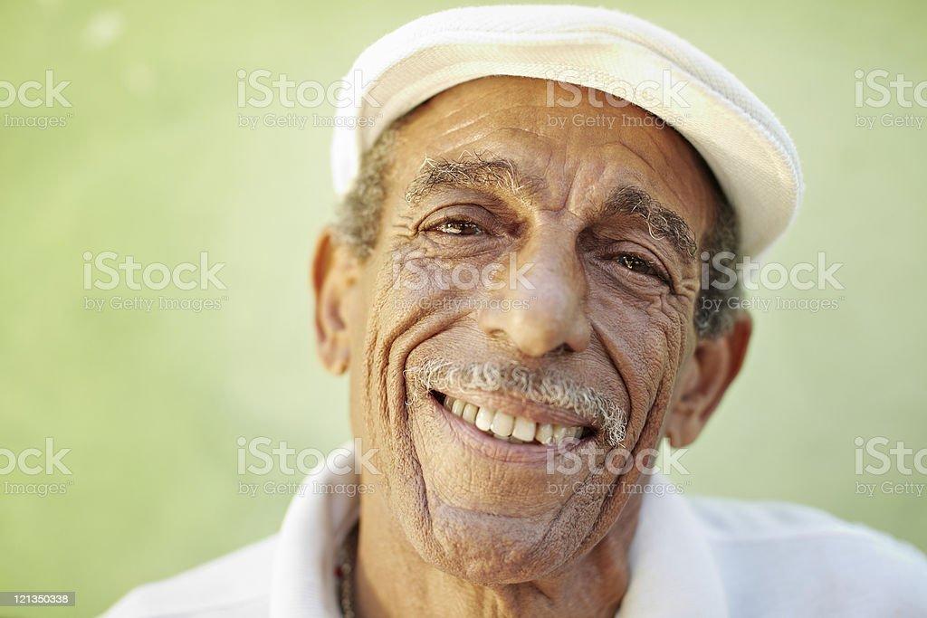 aged latino man smiling at camera royalty-free stock photo