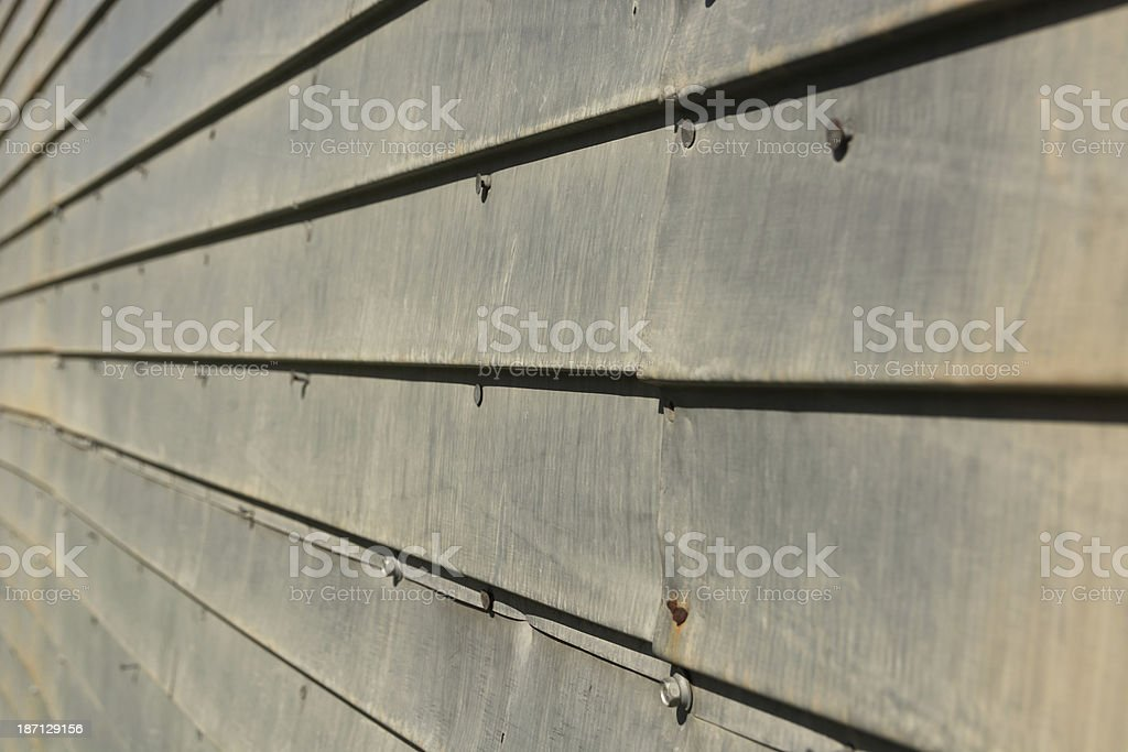 Aged metal siding, side view with nails. royalty-free stock photo