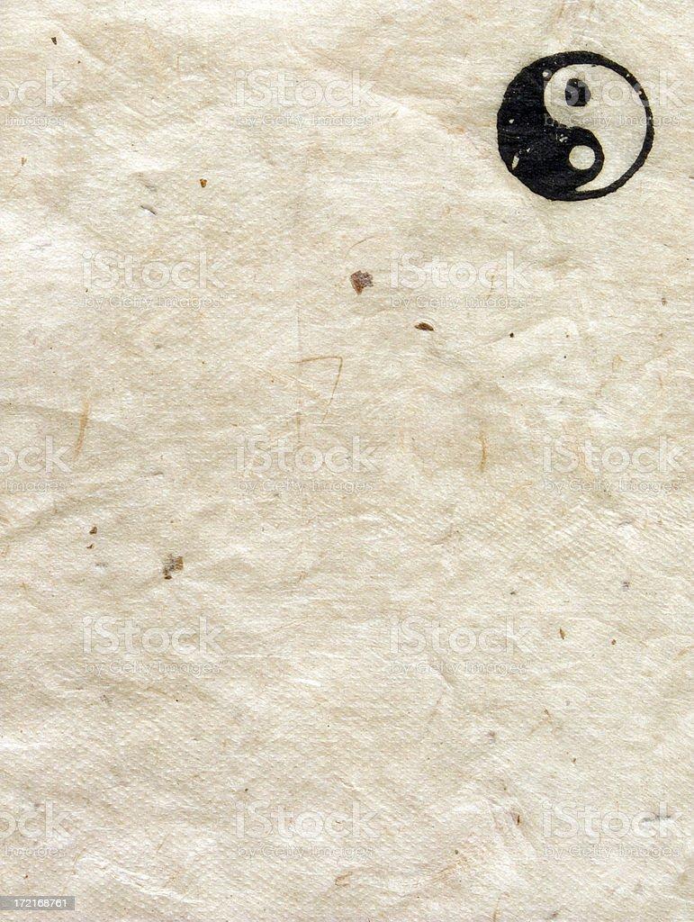 aged nepalese paper: buddhist ying yang symbol stock photo