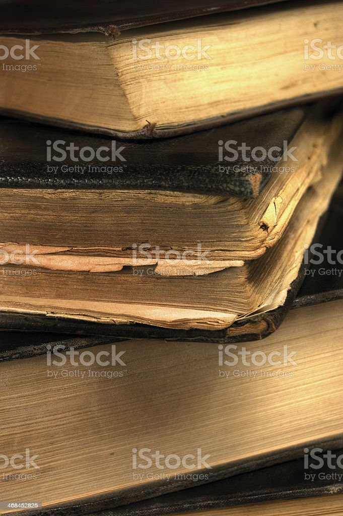 Aged Old Grungy Books Stack Closeup, Sepia, Vertical Vintage Macro royalty-free stock photo
