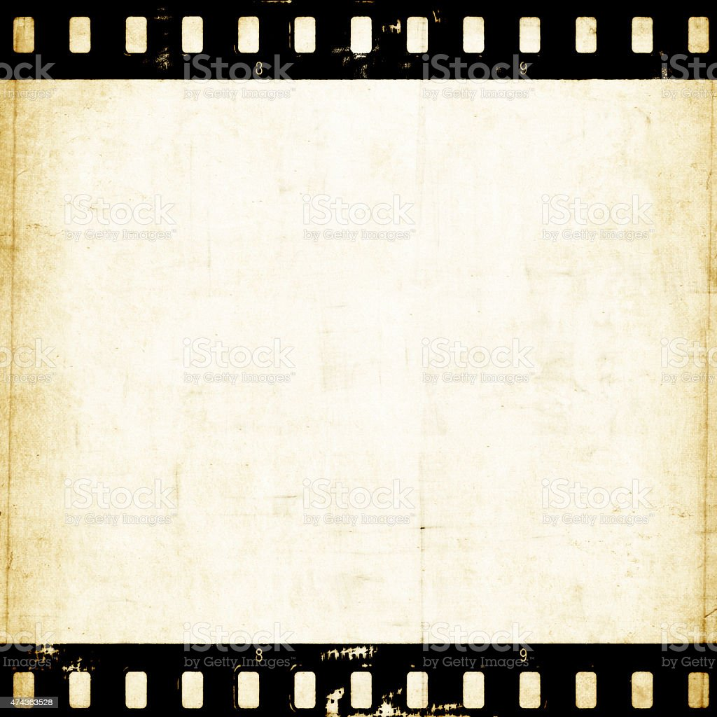 Aged paper background with film strip stock photo