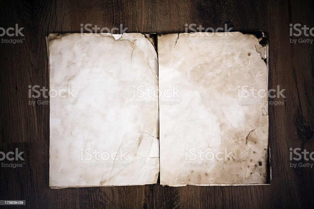 Aged Paper on Wood Background royalty-free stock photo