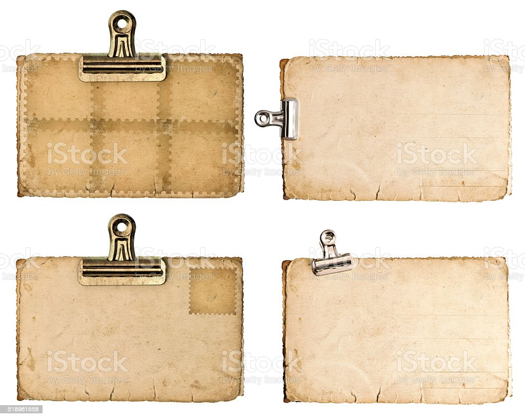 Aged paper sheets with metal clip isolated on white stock photo