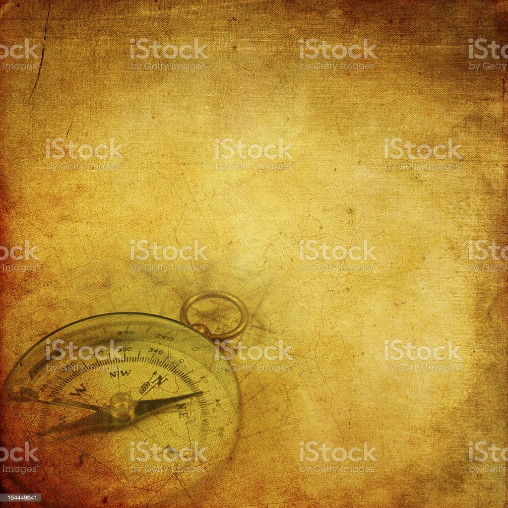 Aged paper with compass stock photo