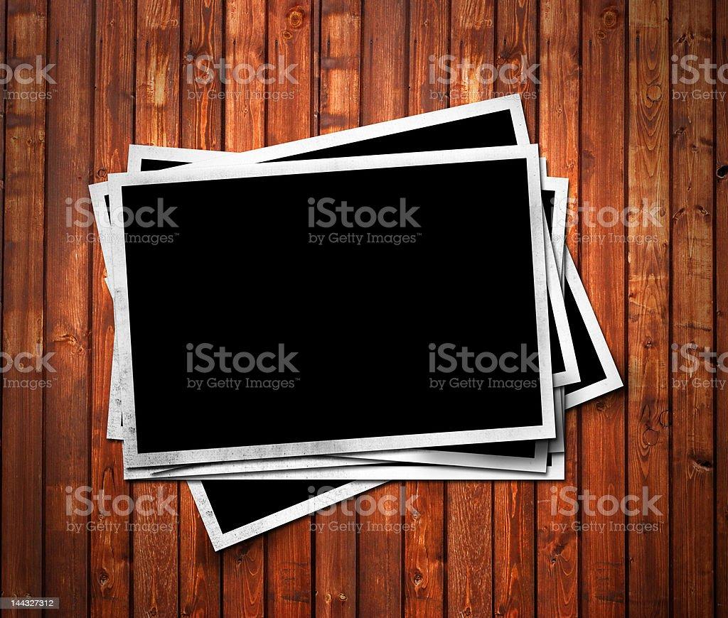 Aged photo frames on wood background royalty-free stock photo
