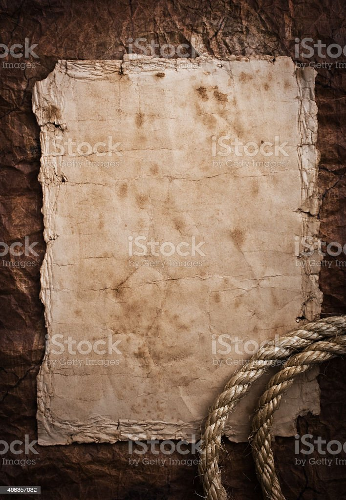 aged Rope on the old paper background royalty-free stock photo