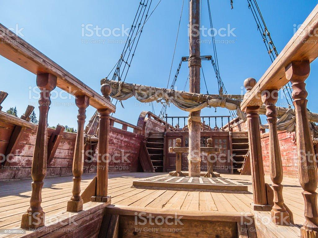 Aged sailing ship on ashore stock photo
