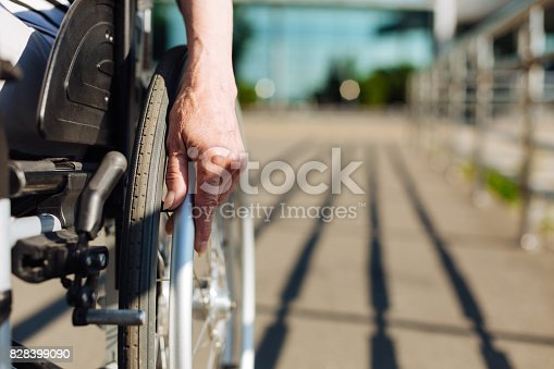 istock Aged strong lady rolling the wheelchair 828399090
