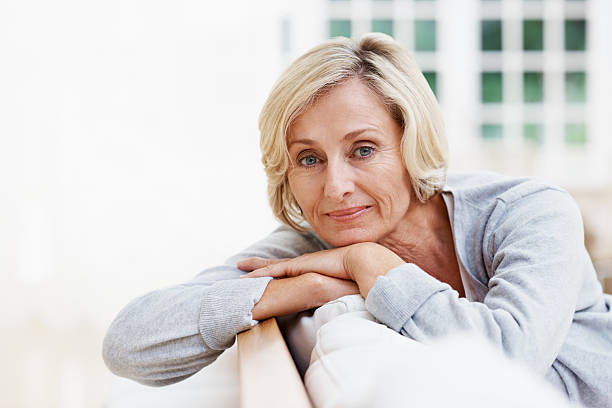 Aged to perfection An attractive senior woman relaxing at home 60 64 years stock pictures, royalty-free photos & images