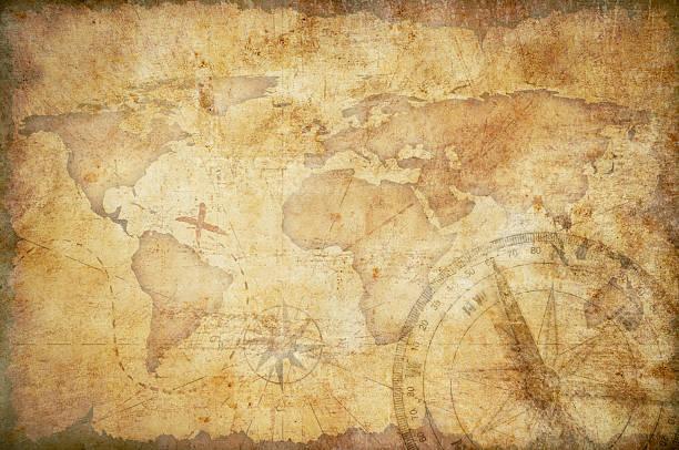 mapa del tesoro envejecido con fondo brújula - anticuario anticuado fotografías e imágenes de stock