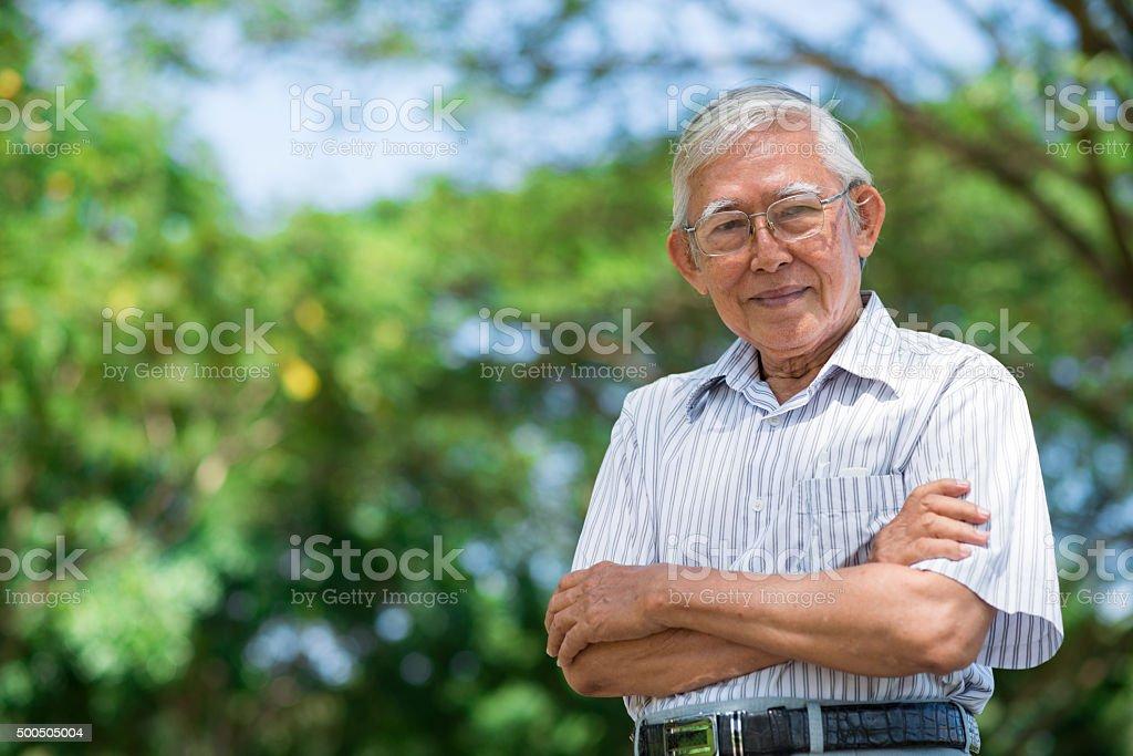 Aged Vietnamese man stock photo