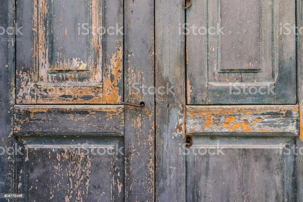 aged vintage peeling paint barn wooden door texture as background stock photo