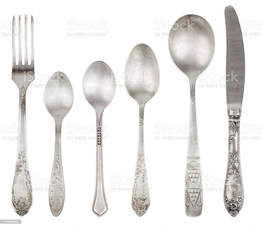 Aged vintage silver fork, knife, spoons stock photo