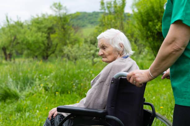 Aged woman in a wheelchair with medical assistance picture id1173735338?b=1&k=6&m=1173735338&s=612x612&w=0&h=dumal02wwxlk4m4tepuen1qmza0z9yosozhpvi7ass4=