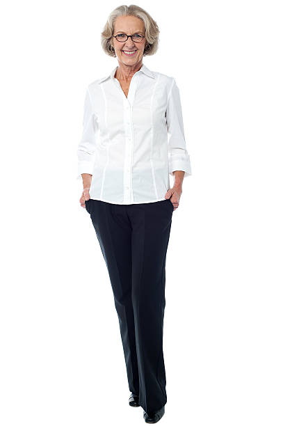Aged woman in corporate attire stock photo