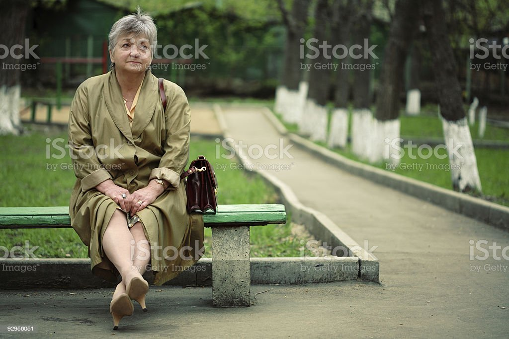 aged woman sitting in park royalty-free stock photo