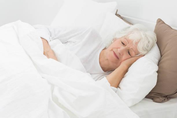 Aged woman sleeping stock photo