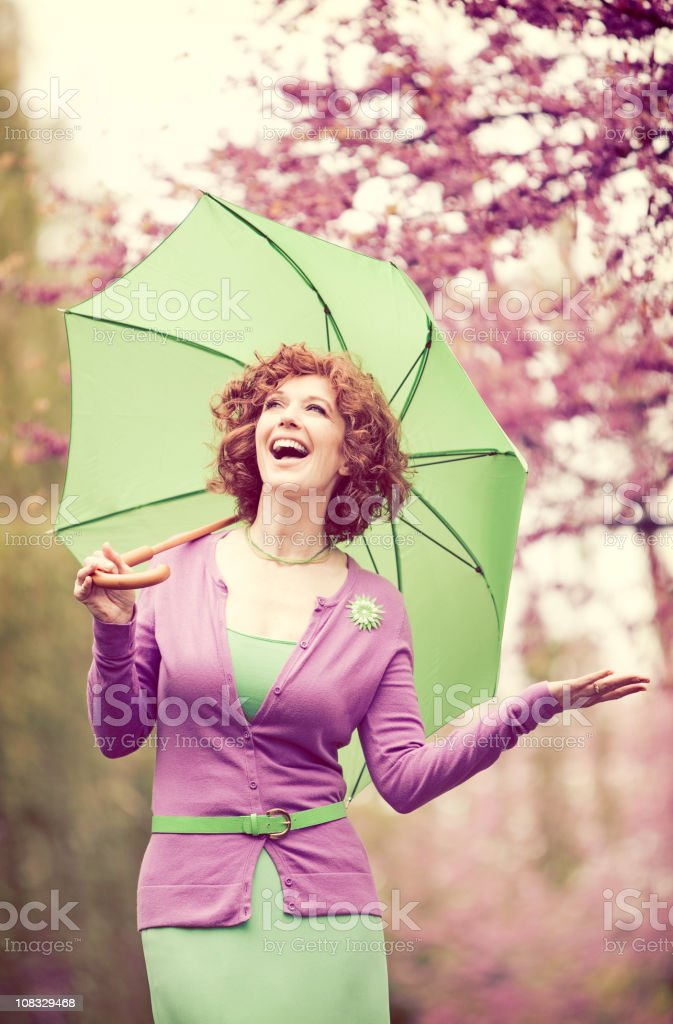 Aged Woman with Umbrella royalty-free stock photo
