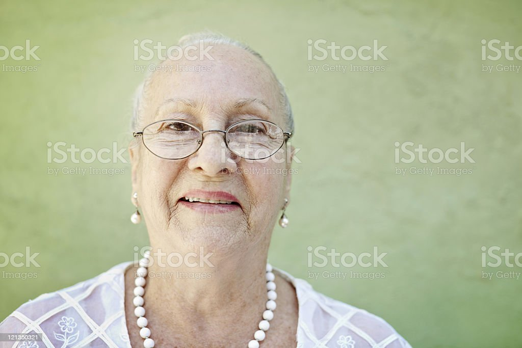 aged woman with white hair smiling at camera royalty-free stock photo