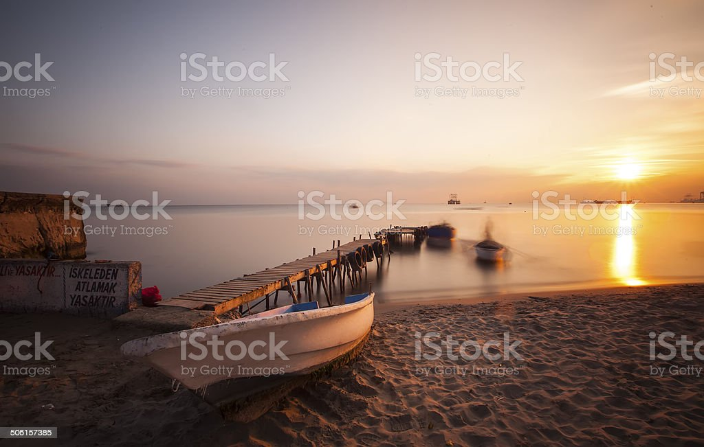 Aged wooden pier and boat royalty-free stock photo