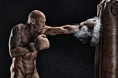 istock Ageing boxer training in the nude 804025110