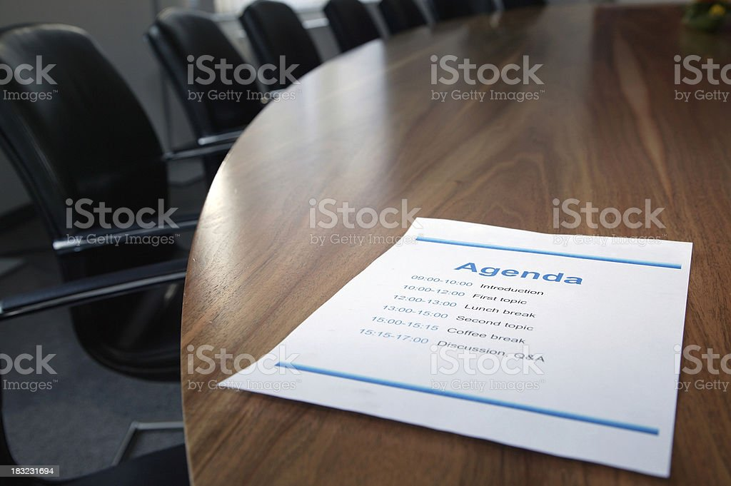 Agenda on boardroom table Printed agenda on a stylish boardroom table with focus on the word 'agenda' Annual Event Stock Photo