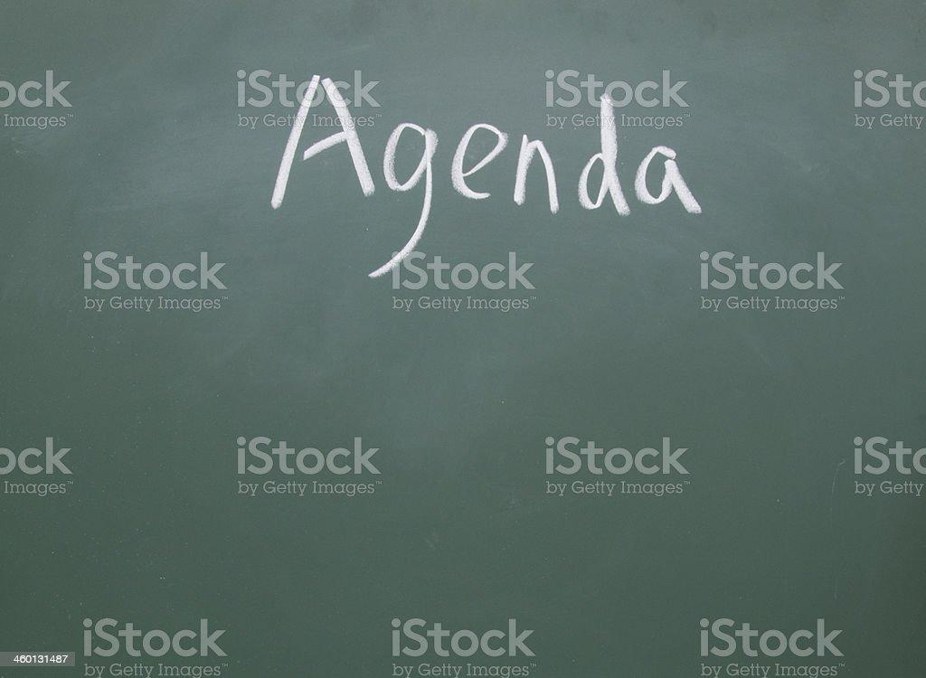 agenda  title handwritten with chalk on blackboard stock photo