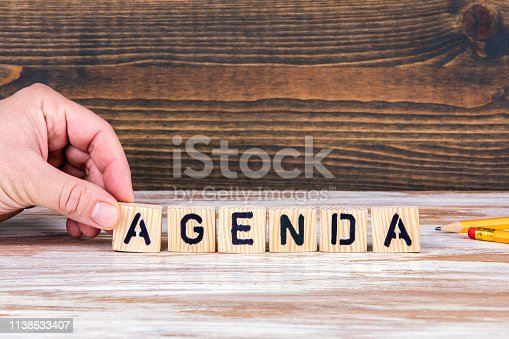 Agenda. Wooden letters on the office desk, informative and communication background