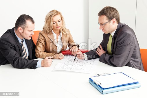 istock Agent Advises Couple Over Blueprint 466848710